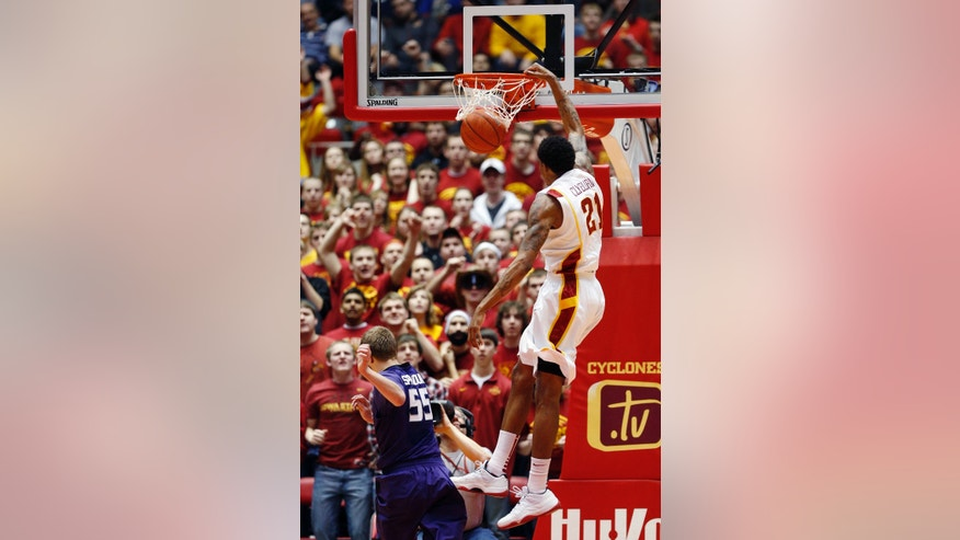 Iowa State guard Will Clyburn, right, dunks over Kansas State guard Will Spradling during the first half of an NCAA college basketball game, Saturday, Jan. 26, 2013, in Ames, Iowa. (AP Photo/Matthew Putney)