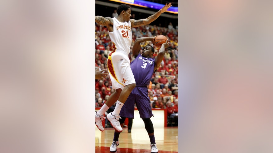 Iowa State guard Will Clyburn (21) defends Kansas State guard Martavious Irving, right, during the first half of an NCAA college basketball game, Saturday, Jan. 26, 2013, in Ames, Iowa. (AP Photo/Matthew Putney)
