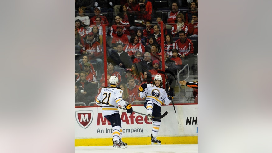 Buffalo Sabres left wing Tyler Ennis (63) celebrates his goal with teammate Buffalo Sabres right wing Drew Stafford (21) against the Washington Capitals during the first period of an NHL hockey game, Sunday, Jan. 27, 2013, in Washington. (AP Photo/Nick Wass)