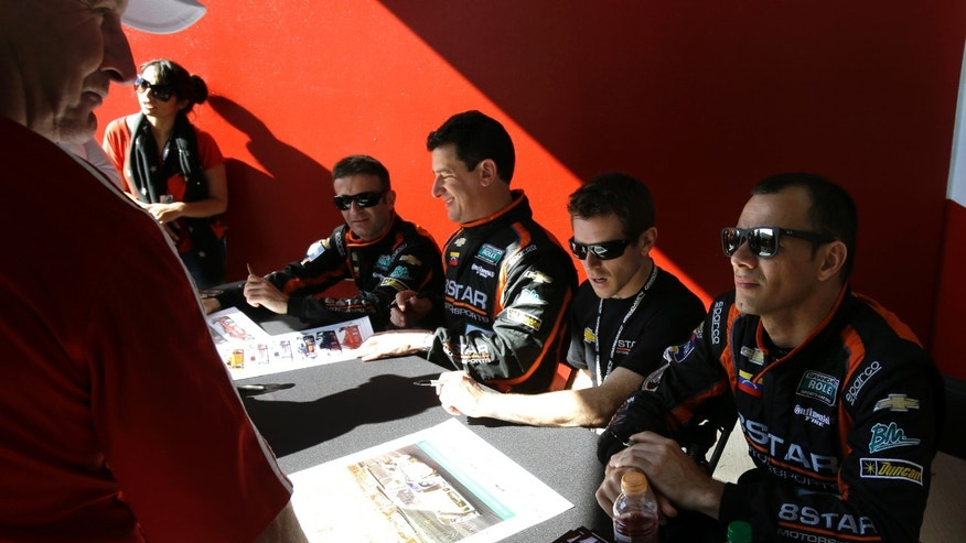 Drivers of the 8 Star Motorsports Corvette DP, from left, Nicolas Minnassian, of France, Enzo Potolicchio, of Venezuela, Anthony Davidson, of England and Stephane Sarrazin, of France, sign autographs for fans prior Grand-Am Series Rolex 24 hour auto race at Daytona International Speedway, Saturday, Jan. 26, 2013, in Daytona Beach, Fla. (AP Photo/John Raoux)