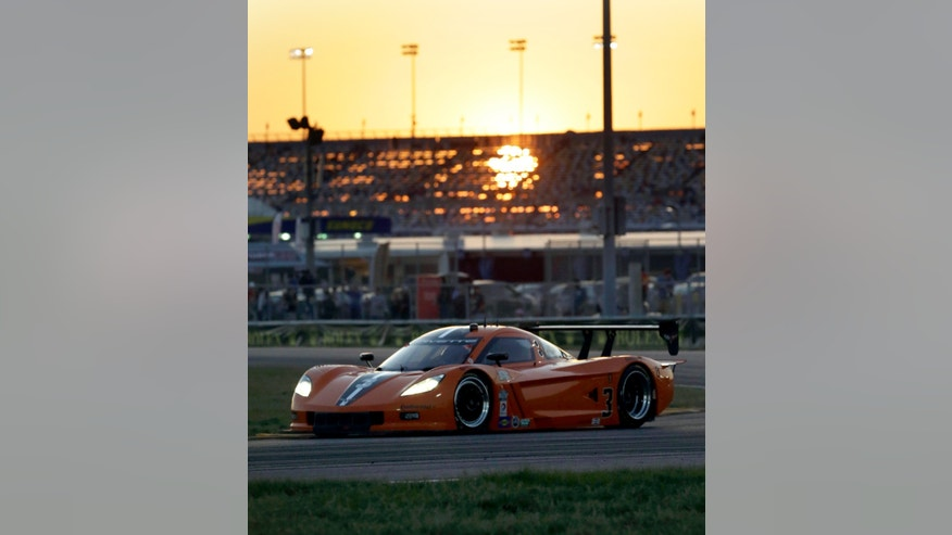 The 8 Star Motorsports Corvette DP drives through the horseshoe turn at sunset in the Grand-Am Series Rolex 24 hour auto race at Daytona International Speedway, Saturday, Jan. 26, 2013, in Daytona Beach, Fla. (AP Photo/John Raoux)