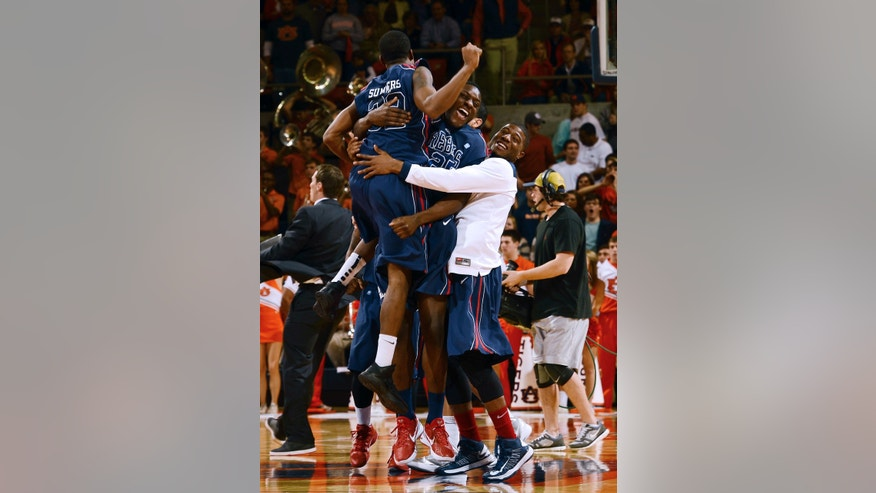 Mississippi players celebrate after defeating Auburn 63-61 in their NCAA college basketball game on Saturday, Jan. 26, 2013 in Auburn, Ala. (AP Photo/Todd J. Van Emst)