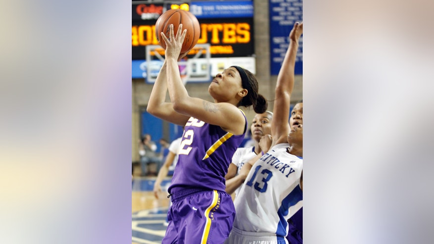 LSU's Danielle Ballard, left, shoots next to Kentucky's Bria Goss during the first half of an NCAA college basketball game at Memorial Coliseum in Lexington, Ky., Sunday, Jan. 27, 2013. (AP Photo/James Crisp)