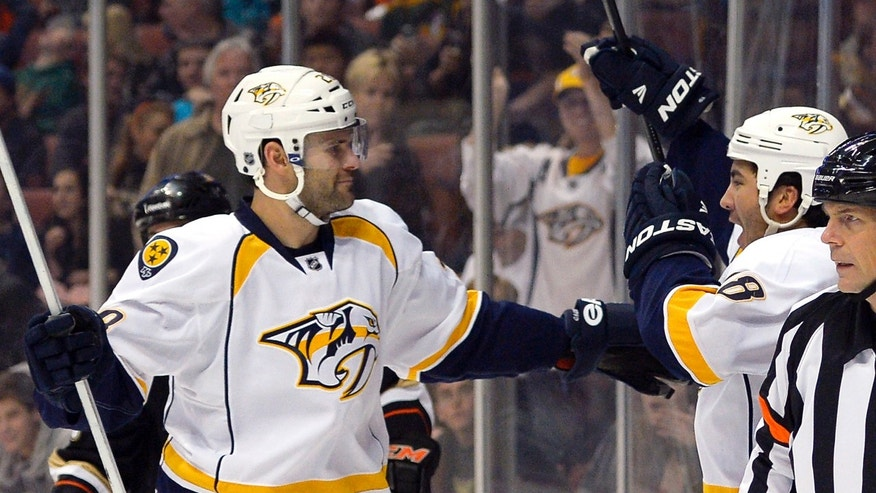 Nashville Predators right wing Brandon Yip, right, celebrates his goal with center Paul Gaustad during the first period of their NHL hockey game against the Anaheim Ducks on Saturday, Jan. 26, 2013, in Anaheim, Calif. (AP Photo/Mark J. Terrill)