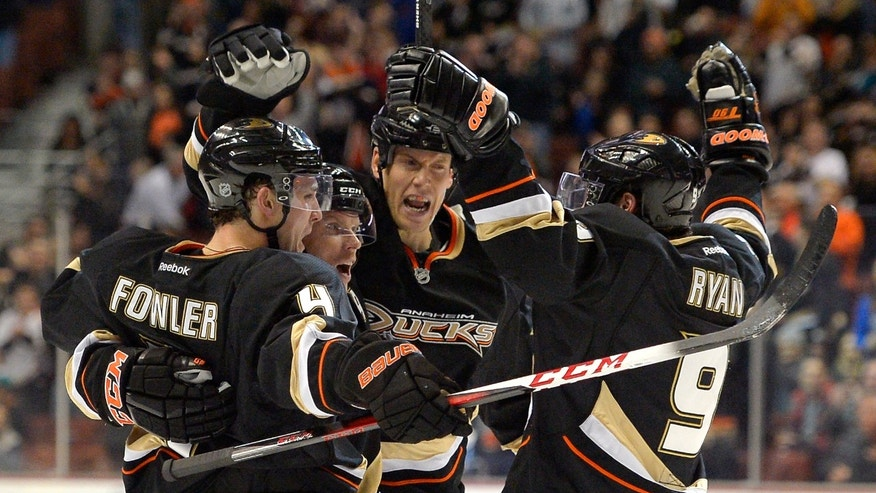 Anaheim Ducks right wing Bobby Ryan, right, celebrates his goal with defenseman Cam Fowler, left, center Saku Koivu, second from left, of Finland, and defenseman Bryan Allen during the second period of their NHL hockey game against the Nashville Predators, Saturday, Jan. 26, 2013, in Anaheim, Calif. (AP Photo/Mark J. Terrill)