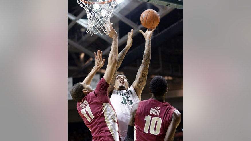 Miami's Julian Gamble (45) shoots over Florida State's Kiel Turpin (11) and Okaro White (10) during the first half of an NCAA college basketball game in Coral Gables, Fla., Sunday, Jan. 27, 2013. (AP Photo/Alan Diaz)