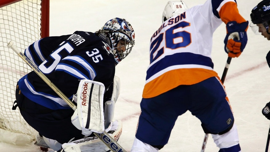 Winnipeg Jets goaltender Al Montoya (35) stops New York Islanders' Matt Moulson (26) in front of the net during the second period of their NHL hockey game, Sunday, Jan. 27, 2013, in Winnipeg, Manitoba. (AP Photo/The Canadian Press, Trevor Hagan)