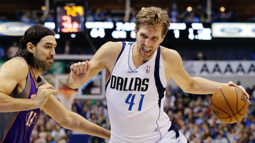 Dallas Mavericks' Dirk Nowitzki (41), of Germany, drives by Phoenix Suns' Luis Scola, left, of Argentina, during the second half of an NBA basketball game, Sunday, Jan. 27, 2013, in Dallas. Nowitzki scored 18 points in his 1,000th game as the Mavericks won 110-95. (AP Photo/Tony Gutierrez)