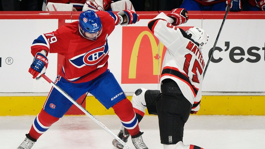 Montreal Canadiens' Andrei Markov (79) collides with New Jersey Devils' Stefan Matteau (15) during the second period of their NHL hockey game, Sunday, Jan. 27, 2013, in Montreal. (AP Photo/The Canadian Press, Graham Hughes)