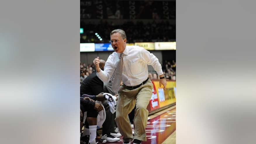 Southern Illinois head coach Barry Hinson yells to a player to enter the game during the first period of an NCAA college basketball game against Creighton at SIU Arena in Carbondale, Ill., Sunday, Jan. 27, 2013. (AP Photo/Stephen Lance Dennee)
