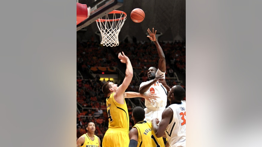 Illinois' Sam McLaurin (0) shoots over Michigan's Mitch McGary (4) during the first half of an NCAA college basketball game, Sunday, Jan. 27, 2013, in Champaign, Ill. (AP Photo/John Dixon)