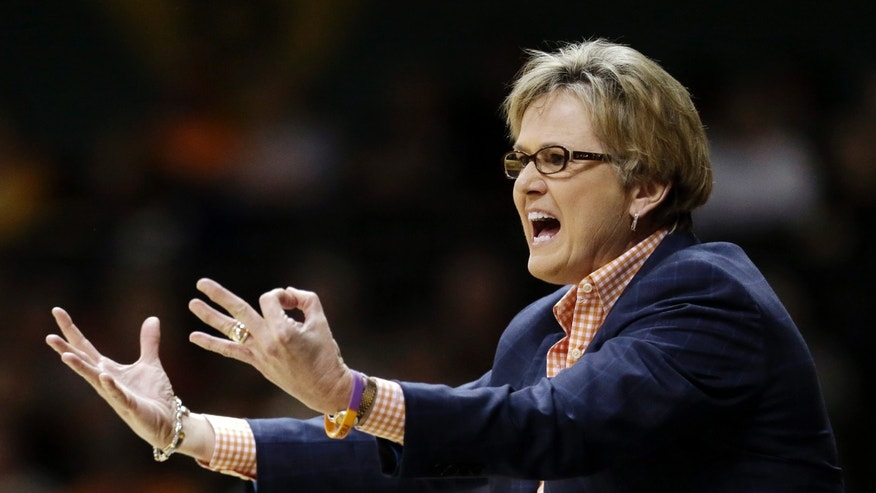 Tennessee head coach Holly Warlick yells to her players in the first half of an NCAA college basketball game against Vanderbilt, Thursday, Jan. 24, 2013, in Nashville, Tenn. (AP Photo/Mark Humphrey)