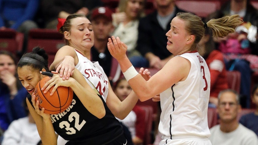 Colorado 's Arielle Roberson (32), left, grabs a rebound next to Stanford 's Joslyn Tinkle (44) and Mikaela Ruef (3) during the first half of an NCAA college basketball game in Stanford, Calif., Sunday, Jan. 27, 2013. (AP Photo/Marcio Jose Sanchez)