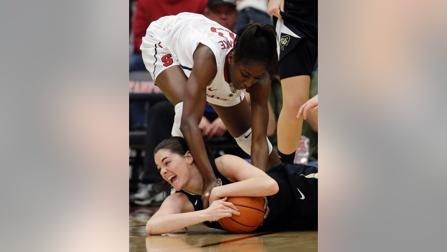 Colorado 's Meagan Malcolm-Peck (14), bottom, battles for a loose ball against Stanford's Chiney Ogwumike (13) during the first half of an NCAA college basketball game in Stanford, Calif., Sunday, Jan. 27, 2013. (AP Photo/Marcio Jose Sanchez)