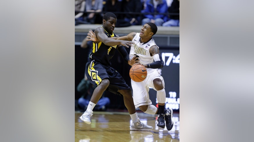 Purdue guard Ronnie Johnson, right, gets tied up with Iowa guard Anthony Clemmons in the first half of an NCAA college basketball game in West Lafayette, Ind., Sunday, Jan. 27, 2013. (AP Photo/Michael Conroy)