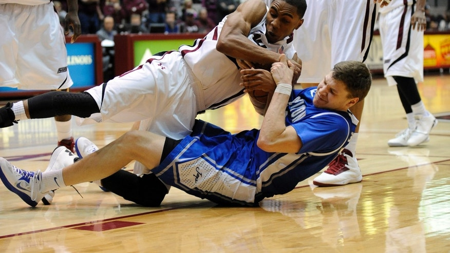 Southern Illinois' Josh Swan (21) and Creighton's Grant Gibbs (10) battle for a loose ball during the second period of a NCAA college basketball game at SIU Arena in Carbondale, Ill., Sunday, Jan. 27, 2013. (AP Photo/Stephen Lance Dennee)