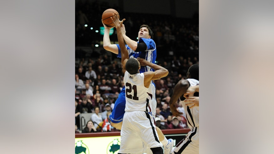 Creighton's Doug McDermott (3) shoots over Southern Illinois' Josh Swan (21) during the second period of a NCAA college basketball game at SIU Arena in Carbondale, Ill., Sunday, Jan. 27, 2013. (AP Photo/Stephen Lance Dennee)