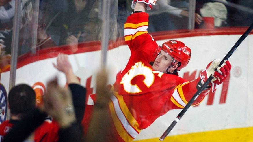 Calgary Flames' Curtis Glencross celebrates his goal against the Edmonton Oilers during the second period of an NHL hockey game in Calgary, Alberta, Saturday, Jan. 26, 2013. (AP Photo/The Canadian Press, Jeff McIntosh)