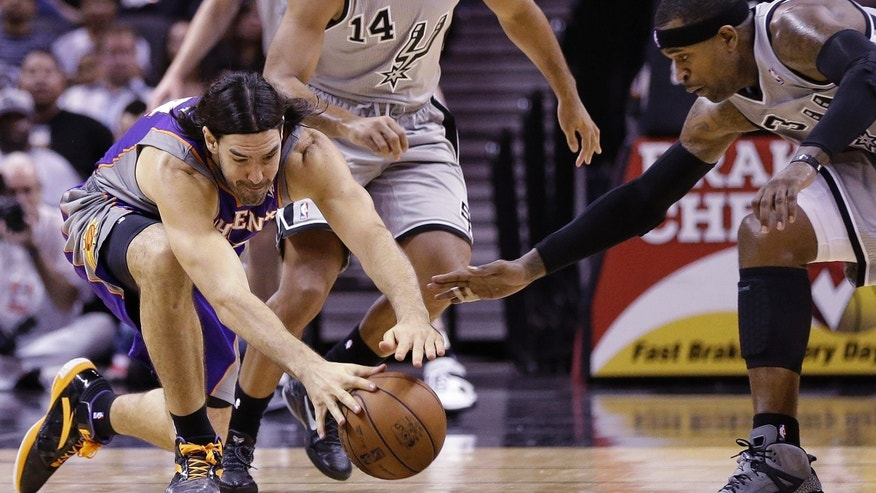 Phoenix Suns' Luis Scola, left, of Argentina, and San Antonio Spurs' Stephen Jackson, right, chase a loose ball during the second quarter of an NBA basketball game, Saturday, Jan. 26, 2013, in San Antonio, Texas. (AP Photo/Eric Gay)