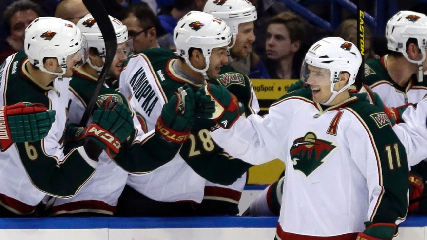 Minnesota Wild's Zach Parise (11) is congratulated by teammates after scoring during the second period of an NHL hockey game against the St. Louis Blues Sunday, Jan. 27, 2013, in St. Louis. (AP Photo/Jeff Roberson)
