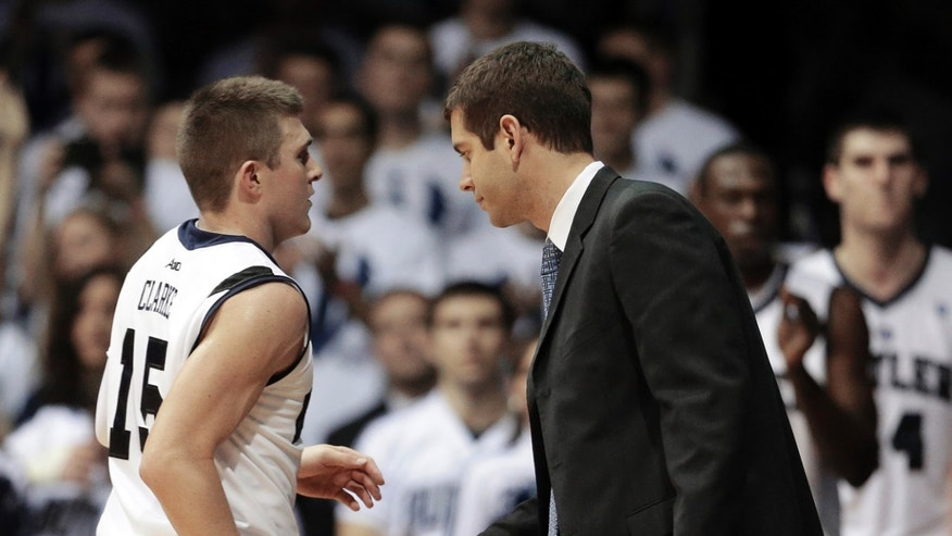 Butler's Rotnei Clarke (15) is congratulated by head coach Brad Stevens late in the second half of an NCAA college basketball game against Temple on Saturday, Jan. 26, 2013, in Indianapolis. Butler defeated Temple 83-71. (AP Photo/Darron Cummings)