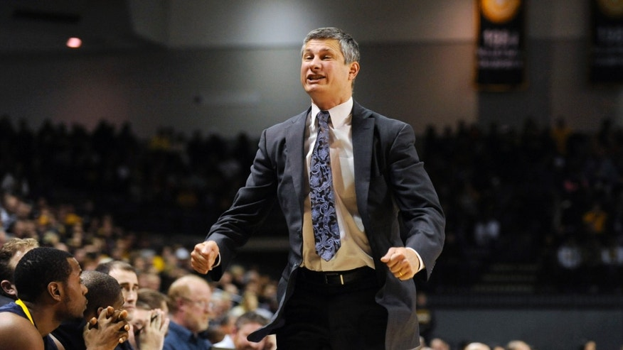 La Salle coach John Giannini reacts to a call during the second half of an NCAA college basketball game against Virginia Commonwealth on Saturday, Jan. 26, 2013, in Richmond, Va. (AP Photo/Clement Britt)