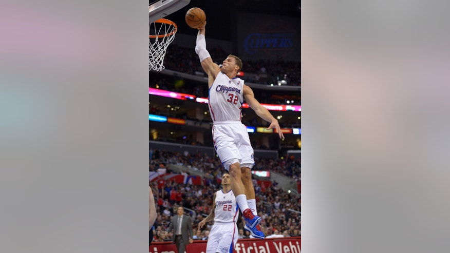 Los Angeles Clippers forward Blake Griffin, right, goes up for a dunk as forward Matt Barnes looks on during the first half of an NBA basketball game against the Portland Trail Blazers, Sunday, Jan. 27, 2013, in Los Angeles. (AP Photo/Mark J. Terrill)