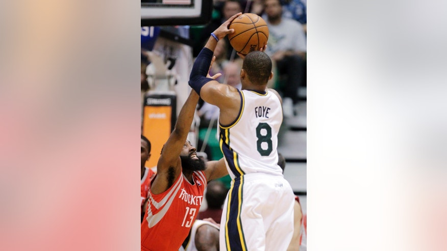 Utah Jazz's Randy Foye (8) shoots as Houston Rockets' James Harden (13) defends during the second quarter of an NBA basketball game, Monday, Jan. 28, 2013, in Salt Lake City. (AP Photo/Rick Bowmer)