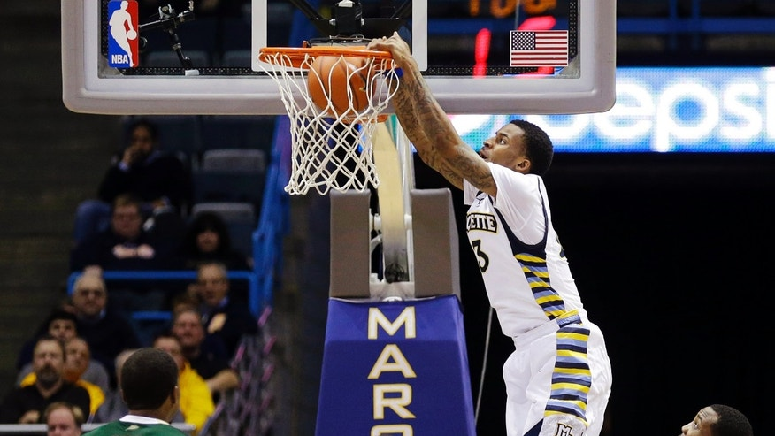 Marquette's Vander Blue (13) dunks the ball against South Florida during the second half of an NCAA college basketball game, Monday, Jan. 28, 2013, in Milwaukee. (AP Photo/Jeffrey Phelps)