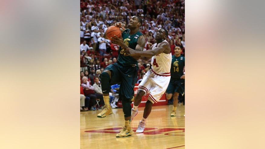 Michigan State's Branden Dawson goes to the basket against Indiana's Victor Oladipo (4) during the first half of an NCAA college basketball game on Sunday, Jan. 27, 2013, in Bloomington, Ind. (AP Photo/Darron Cummings)