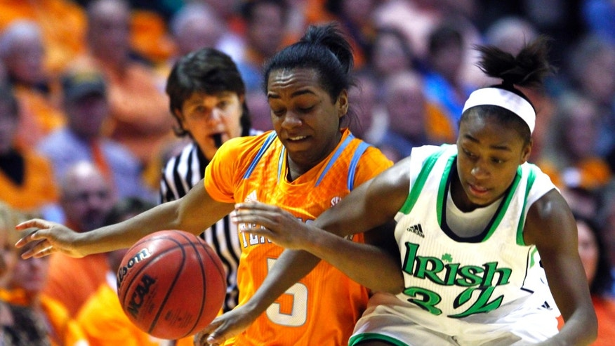 Tennessee guard Ariel Massengale (5) battles for the ball with Notre Dame guard Jewell Loyd (32) in the first half of an NCAA college basketball game on Monday, Jan. 28, 2013, in Knoxville, Tenn. Notre Dame won 77-67. (AP Photo/Wade Payne)