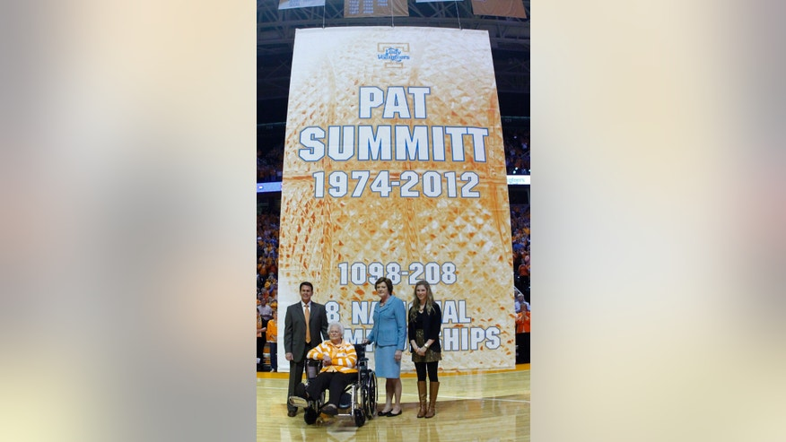 Tennessee Athletic Director Dave Hart, left, stands with head coach emeritus Pat Summitt, third from left, her mother Hazel Head, seated, and future daughter-in-law AnDe Ragsdale as a banner in Summitt's honor was raised before an NCAA college basketball game between the Tennessee and the Notre Dame on Monday, Jan. 28, 2013, in Knoxville, Tenn. (AP Photo/Wade Payne)