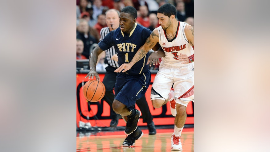 Pittsburgh's Tray Woodall (1) and Louisville's Peyton Siva battle for a loose ball during the first half of their NCAA college basketball game, Monday, Jan. 28, 2013, in Louisville, Ky. (AP Photo/Timothy D. Easley)