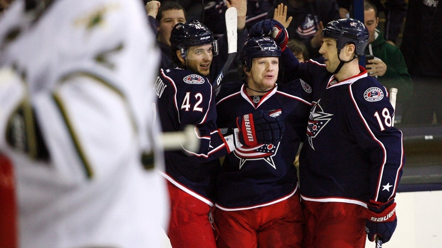 Columbus Blue Jackets' Derek Dorsett, center, celebrates with Artem Anisimov (42) and R.J. Umberger (18) after scoring against the Dallas Stars in the second period of their NHL hockey game, Monday, Jan. 28, 2013, in Columbus, Ohio. (AP Photo/Mike Munden)