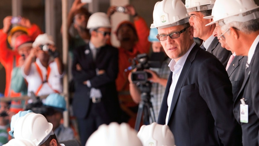 FIFA General Secretary Jerome Valcke attends an inspection of reconstruction work on the National Stadium in Brasilia, Brazil, Monday, Jan. 28, 2013.  The stadium will host games at this year's Confederations Cup and the 2014 World Cup soccer tournament. (AP Photo/Eraldo Peres)