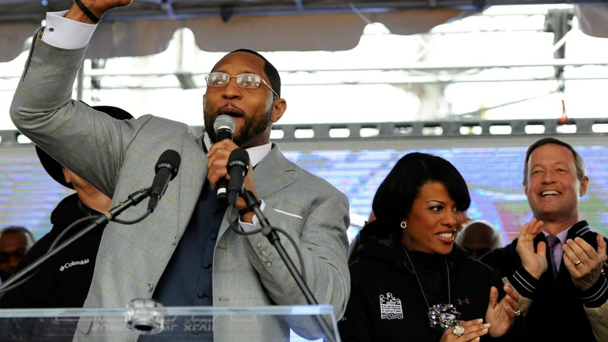 Baltimore Ravens linebacker Ray Lewis, left, addresses fans as Baltimore Mayor Stephanie Rawlings-Blake, center, and Maryland Gov. Martin O'Malley cheer during a send-off rally Monday, Jan. 28, 2013 in Baltimore. The team was leaving for New Orleans to play against the San Francisco 49ers in the Super Bowl. (AP Photo/Steve Ruark)