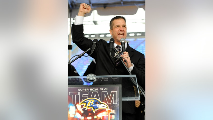 Baltimore Ravens head coach John Harbaugh pumps his fist during a send-off rally Monday, Jan. 28, 2013 in Baltimore. The team was leaving for New Orleans to play against the San Francisco 49ers in the Super Bowl. (AP Photo/Steve Ruark)