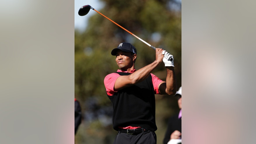 Tiger Woods watches his tee shot on the 10th hole during the fourth round of the Farmers Insurance Open golf tournament at the Torrey Pines Golf Course, Monday, Jan. 28, 2013, in San Diego. (AP Photo/Gregory Bull)