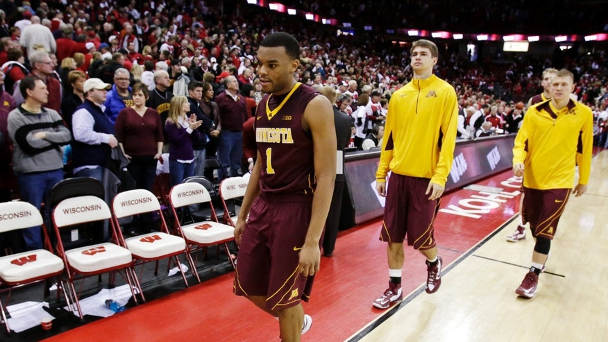 Minnesota's Andre Hollis (1) walks off the court after their 45-44 loss to Wisconsin in an NCAA college basketball game, Saturday, Jan. 26, 2013, in Madison, Wis. (AP Photo/Andy Manis)