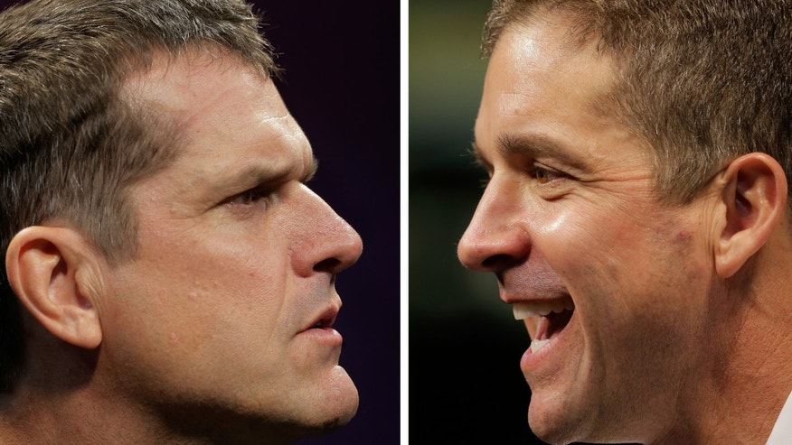 In this combination of photos, Baltimore Ravens head coach John Harbaugh, right, and San Francisco 49ers head coach Jim Harbaugh speak during their team's media day for the NFL Super Bowl XLVII football game Tuesday, Jan. 29, 2013, in New Orleans. The brothers will be the first to face off as dueling head coaches in the Super Bowl. (AP Photo/Charlie Riedel)