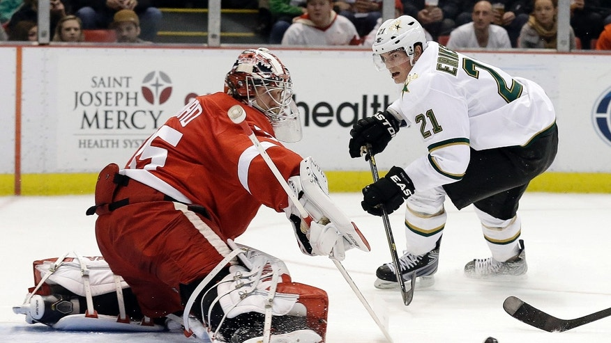 Detroit Red Wings goalie Jimmy Howard (35) stops a shot by Dallas Stars' Loui Eriksson (21) shot during the first period of an NHL hockey game in Detroit, Tuesday, Jan. 29, 2013. (AP Photo/Paul Sancya)