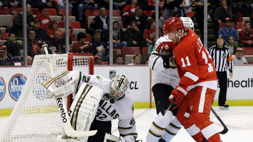 Dallas Stars goalie Kari Lehtonen (32), of Finland, stops a shot as Detroit Red Wings wing Daniel Cleary (11) waits for the rebound next to Dallas Stars defenseman Jordie Benn (58) during the second period of an NHL hockey game in Detroit, Tuesday, Jan. 29, 2013. (AP Photo/Paul Sancya)