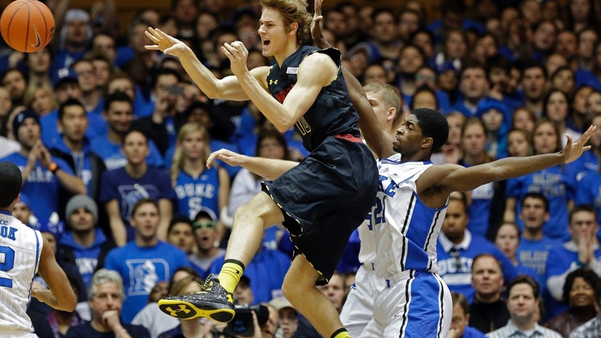 Duke's Amile Jefferson, right, guards Maryland's Jake Layman during the first half of an NCAA college basketball game in Durham, N.C., Saturday, Jan. 26, 2013. (AP Photo/Gerry Broome)