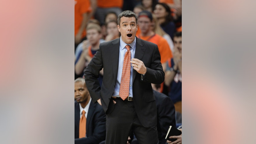 Virginia coach Tony Bennett calls to his team during the first half of an NCAA college basketball game against North Carolina State on Tuesday, Jan. 29, 2013, in Charlottesville, Va. (AP Photo/Steve Helber)