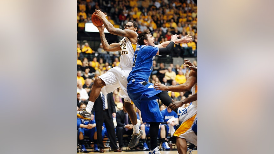 Wichita State's Carl Hall grabs a rebound against Indiana State's RJ Mahurin in the first half during an NCAA college basketball game in Wichita, Kan., Tuesday, Jan. 29, 2013. (AP Photo/The Wichita Eagle, Fernando Salazar)