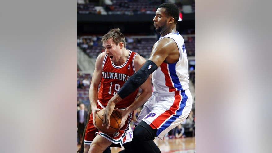 Milwaukee Bucks guard Beno Udrih (19) goes to the basket as Detroit Pistons forward Andre Drummond, right, tries to knock the ball away in the first half of an NBA basketball game Tuesday, Jan. 29, 2013, in Detroit. (AP Photo/Duane Burleson)