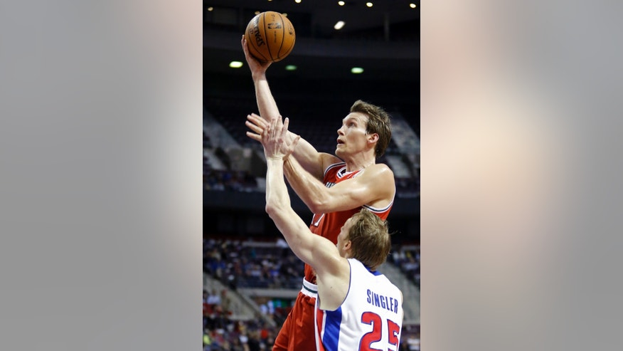 Milwaukee Bucks forward Mike Dunleavy goes to the basket past Detroit Pistons forward Kyle Singler (25) in the first half of an NBA basketball game Tuesday, Jan. 29, 2013, in Auburn Hills, Mich. (AP Photo/Duane Burleson)
