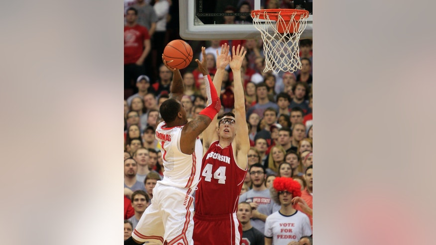 Ohio State's Deshaun Thomas, left, shoots over Wisconsin's Frank Kaminsky during the first half of an NCAA college basketball game Tuesday, Jan. 29, 2013, in Columbus, Ohio. (AP Photo/Jay LaPrete)