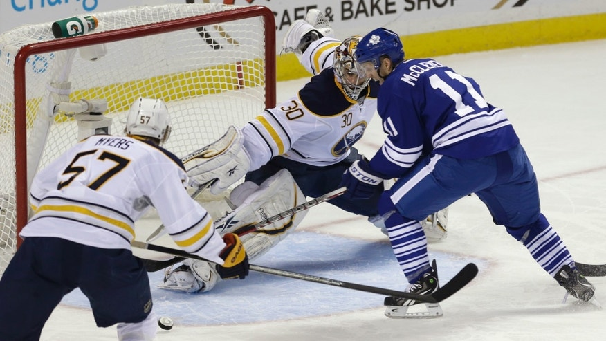 Toronto Maple Leafs' Jay McClement (11) scores on Buffalo Sabres' Ryan Miller as Sabres' Tyler Myers (57) defends during the first period of an NHL hockey game in Buffalo, N.Y., Tuesday, Jan. 29, 2013. (AP Photo/David Duprey)