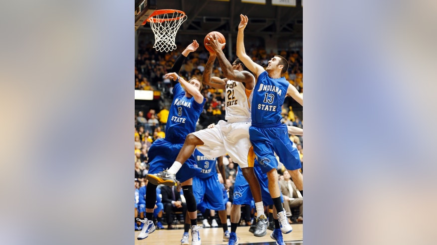 Wichita State's Carl Hall (22) pulls down a rebound against Indiana State's Justin Gant (5) and Jake Odum (13) in the first half during an NCAA college basketball game in Wichita, Kan., Tuesday, Jan. 29, 2013. (AP Photo/The Wichita Eagle, Fernando Salazar)